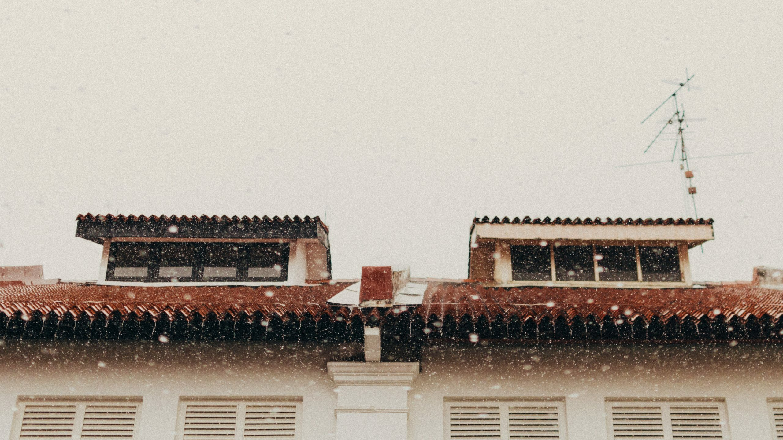 rain drops on brown roofs